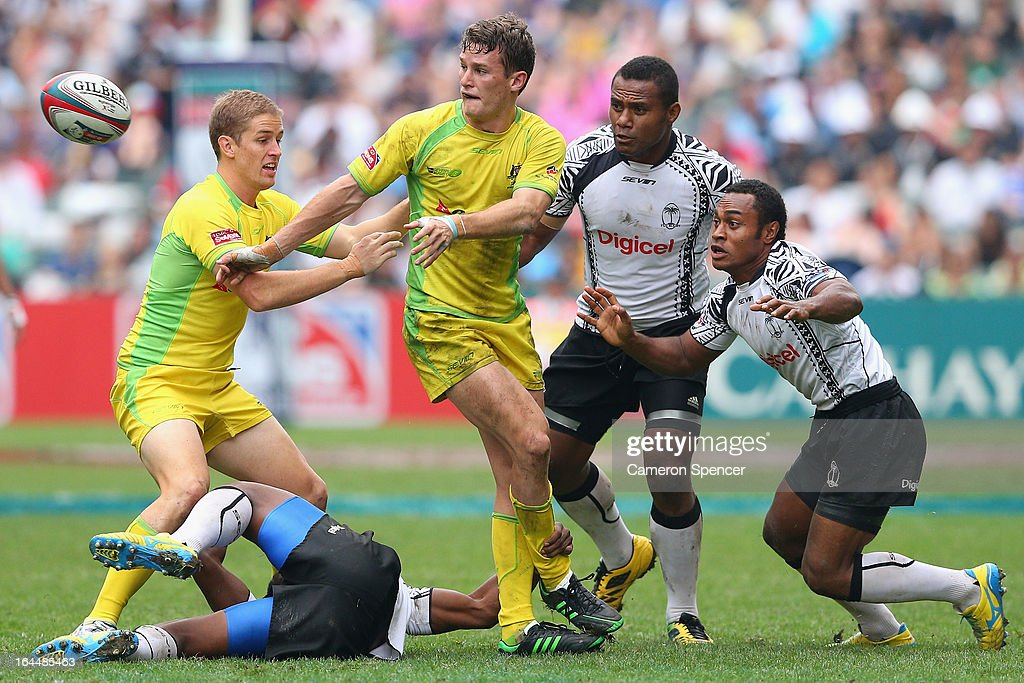 Con Foley of Australia passes during the Cup Quarter Final match between Australia and Fiji during day three of the 2013 Hong Kong Sevens at Hong Kong Stadium on March 24, 2013 in So Kon Po, Hong Kong.