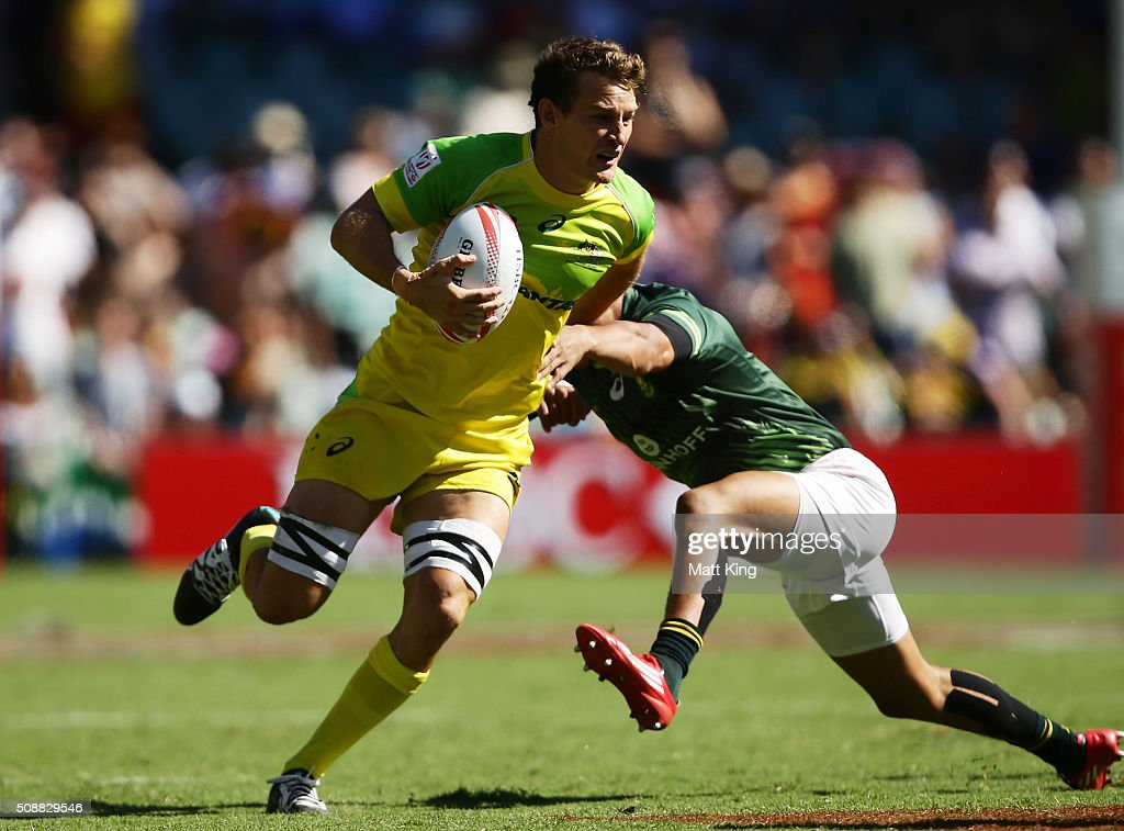 <a gi-track='captionPersonalityLinkClicked' href=/galleries/search?phrase=Con+Foley&family=editorial&specificpeople=8672116 ng-click='$event.stopPropagation()'>Con Foley</a> of Australia takes on the defence during the 2016 Sydney Sevens Cup Semi Final match between Australia and South Africa at Allianz Stadium on February 7, 2016 in Sydney, Australia.