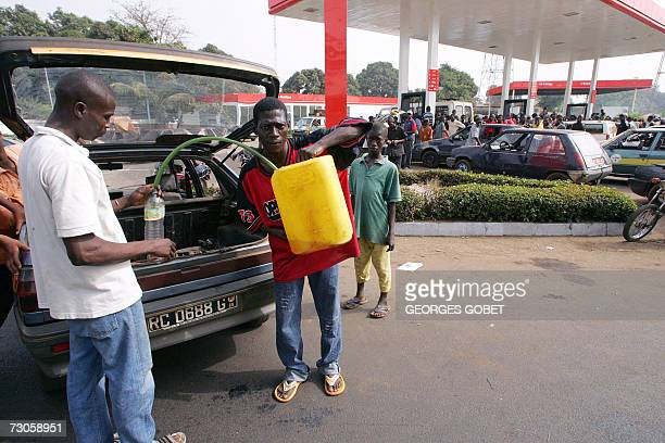 A man sells gas on the 'black market' in front of a petrol station in central Conakry 21 January 2007 Embattled Guinean President Lansana Conte...