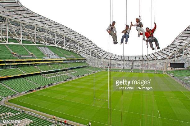 Conall Mallen Lucy Kennedy Adi Roche CEO of Chernobyl Children International and Mike O'Shea of Work at Height training high up on an abseil in the...