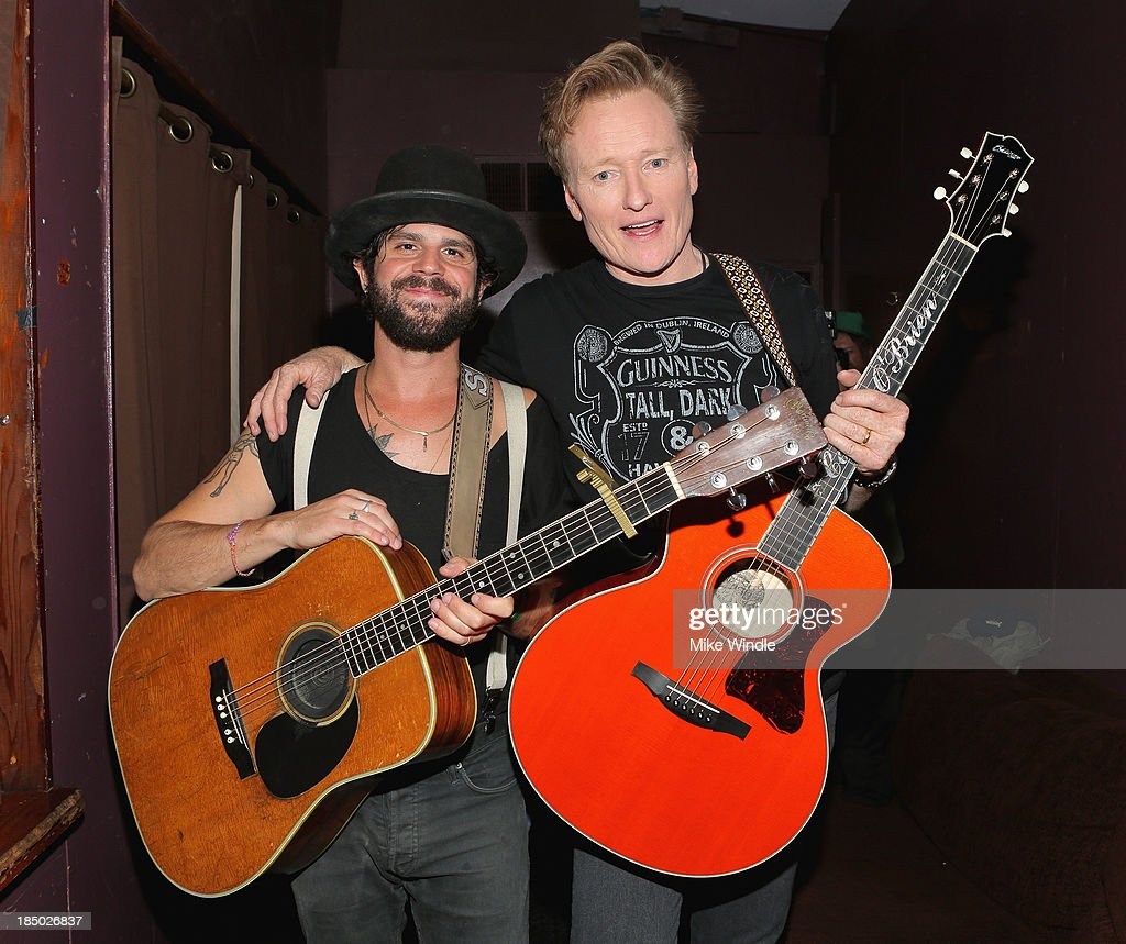<a gi-track='captionPersonalityLinkClicked' href=/galleries/search?phrase=Conan+O%27Brien&family=editorial&specificpeople=208095 ng-click='$event.stopPropagation()'>Conan O'Brien</a> (R) and <a gi-track='captionPersonalityLinkClicked' href=/galleries/search?phrase=Langhorne+Slim&family=editorial&specificpeople=5502245 ng-click='$event.stopPropagation()'>Langhorne Slim</a> pose backstage at the Troubadour on October 16, 2013 in West Hollywood, California.
