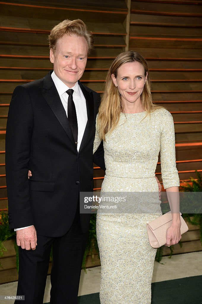 Conan O'Brien and Liza Powel arrive at the 2014 Vanity Fair Oscar Party Hosted By Graydon Carter on March 2, 2014 in West Hollywood, California.