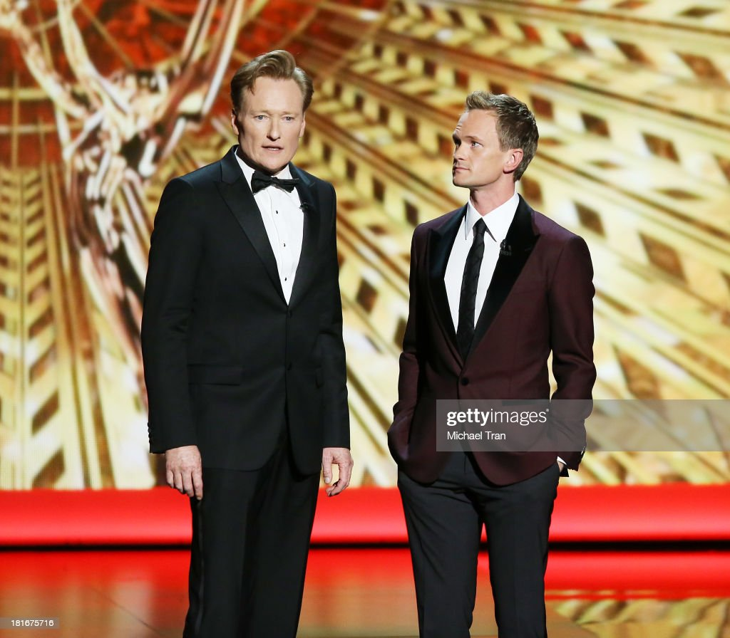<a gi-track='captionPersonalityLinkClicked' href=/galleries/search?phrase=Conan+O%27Brien&family=editorial&specificpeople=208095 ng-click='$event.stopPropagation()'>Conan O'Brien</a> (L) and <a gi-track='captionPersonalityLinkClicked' href=/galleries/search?phrase=Neil+Patrick+Harris&family=editorial&specificpeople=210509 ng-click='$event.stopPropagation()'>Neil Patrick Harris</a> speak onstage during the 65th Annual Primetime Emmy Awards held at Nokia Theatre L.A. Live on September 22, 2013 in Los Angeles, California.