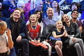Conan O'Brien Neve O'Brien Beckett O'Brien and Liza Powel attend a basketball game between the Houston Rockets and the Los Angeles Clippers at...
