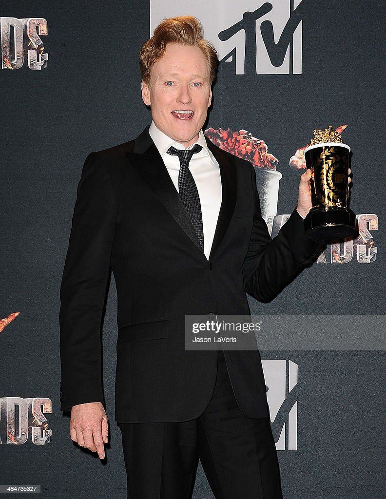 <a gi-track='captionPersonalityLinkClicked' href=/galleries/search?phrase=Conan+O%27Brien&family=editorial&specificpeople=208095 ng-click='$event.stopPropagation()'>Conan O'Brien</a> poses in the press room at the 2014 MTV Movie Awards at Nokia Theatre L.A. Live on April 13, 2014 in Los Angeles, California.