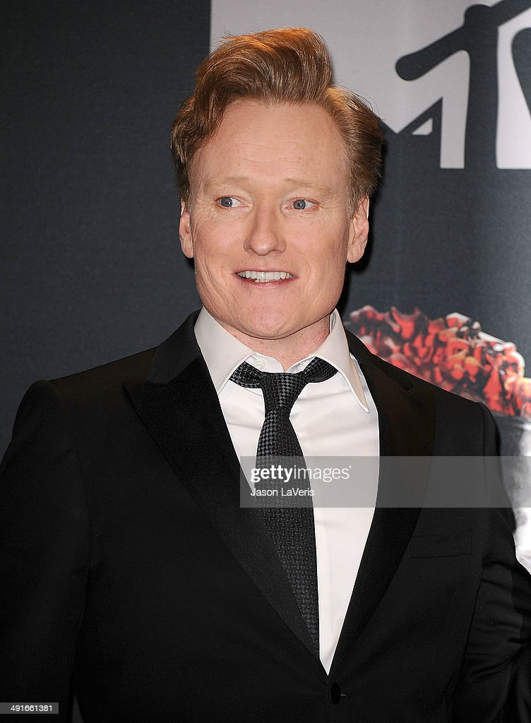 Conan O'Brien poses in the press room at the 2014 MTV Movie Awards at Nokia Theatre L.A. Live on April 13, 2014 in Los Angeles, California.