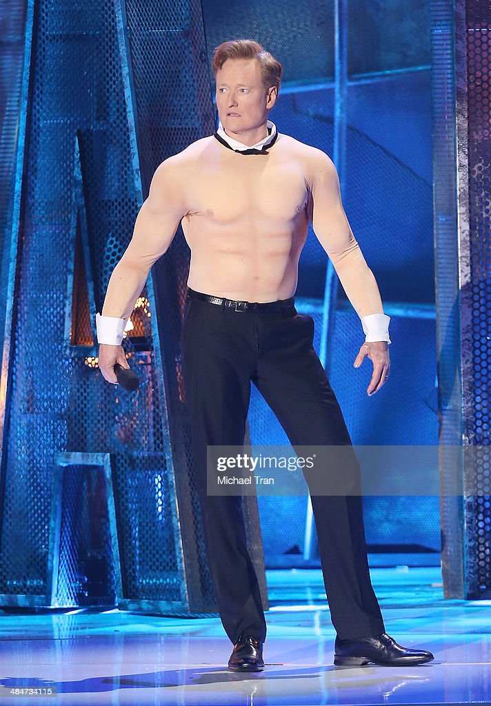 <a gi-track='captionPersonalityLinkClicked' href=/galleries/search?phrase=Conan+O%27Brien&family=editorial&specificpeople=208095 ng-click='$event.stopPropagation()'>Conan O'Brien</a> speaks onstage during the 2014 MTV Movie Awards held at Nokia Theatre L.A. Live on April 13, 2014 in Los Angeles, California.