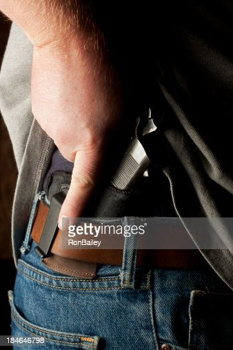 Concealed Carry Firearm Drawn From an Inside-the-Waistband Holst