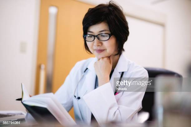 Concentrated female doctor working in hospital