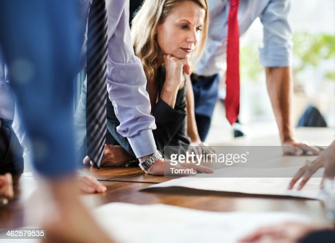 Concentrated Mature Businesswoman During Meeting