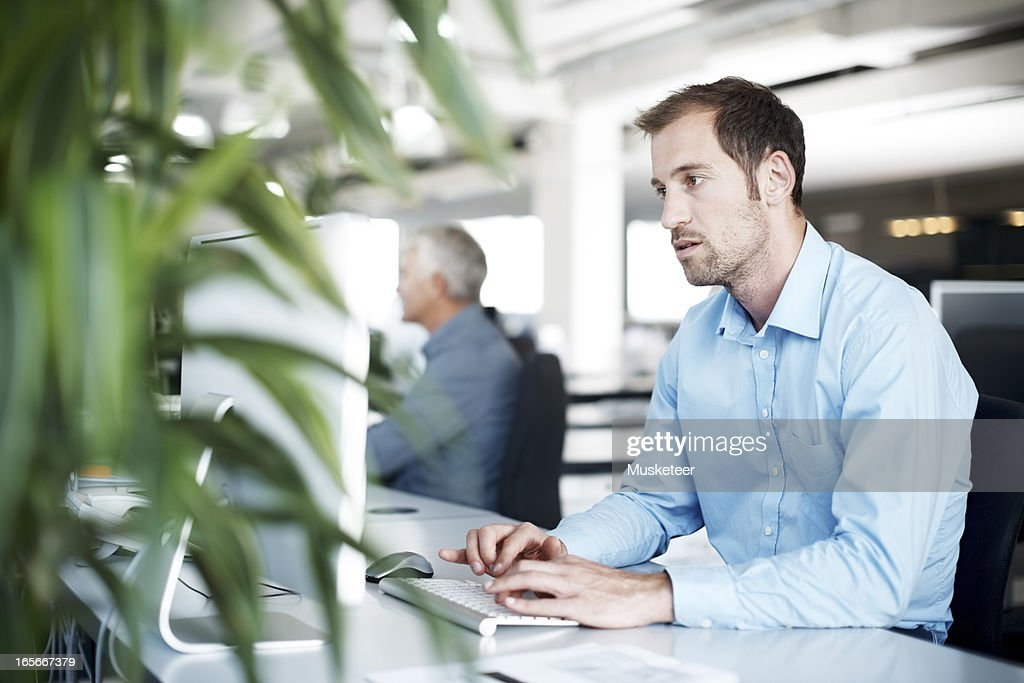 Concentrating man working hard : Stock Photo