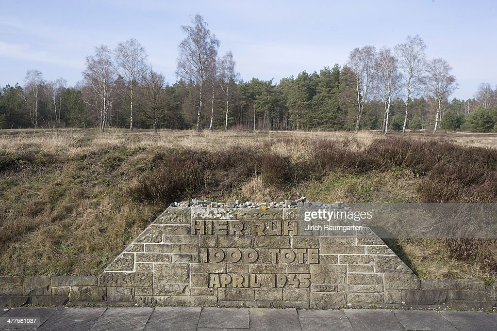 Concentration Camp Bergen-Belsen, memorial stone at a mass grave with the inscription Here rest 1000 dead April 1945, on March 05, 2014 in Bergen-Belsen, Germany.