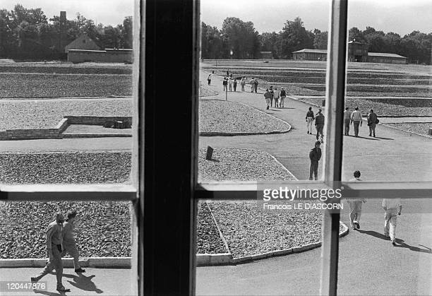 Concentration camps in Germany in 1990 Buchenwald Visitors to Buchenwald concentration camp as seen from the main building They are walking through...