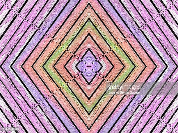 Concentric purple and pink geometric shapes on a pink wooden background