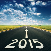 Forward to 2015 new year. Concept on empty, open road on idyllic day