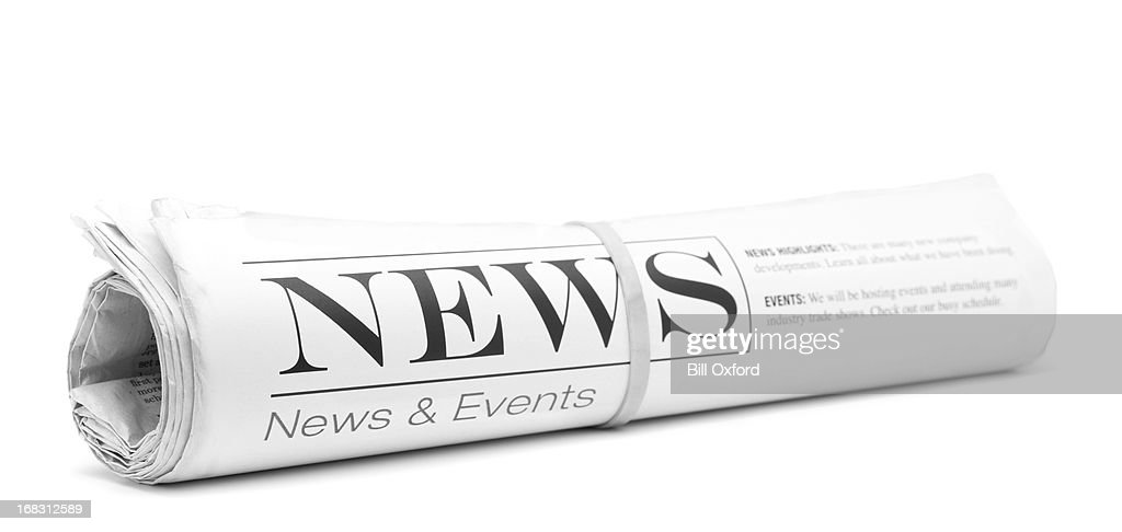 Concept newspaper, rolled up : Stock Photo