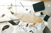 Concept of chaos in the office with flying objects and furnishings