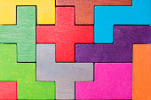 Abstract Background. Background with different colorful shapes wooden blocks . Geometric shapes in different colors. Concept of creative, logical thinking or problem solving.