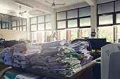 Concept of document workload, Pile of unfinished documents on office desk, Stack of business paper, Vintage effect