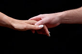 Concept of Emotions. Tenderness. The sense of touch expresses feelings and emotions through the contact with male and female hand