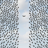Concept of individualism and Individuality symbol or independent thinker idea and new leadership concept or individual courage as a group of birds flying with one individual in the opposite direction