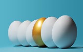 Concept of individuality, exclusivity, better choice. One golden egg among white eggs on blue background.