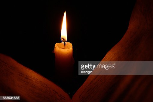concept of knowledge, vintage book candle : Stock Photo