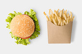 Concept of mock up burger and french fries on white background. Copy space for text and logo.