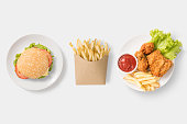 Concept of mock up burger, french fries and fried chicken set isolated on white background. Copy space for text and logo. Clipping Path included on white background.