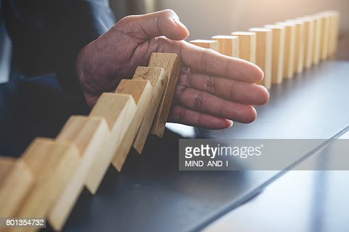 Concept of solution and domino effect.Slightly de-focused and close-up shot. Selective focus. : Stock Photo