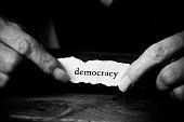 concept paper in hands of woman - Democraty
