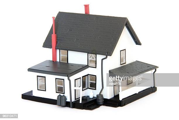 Concept - Real Estate: Model house on white