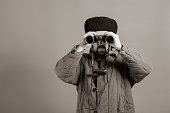 Conception - soldier on the post. Observation with binoculars, uniforms of the Great Patriotic War, sepia effect
