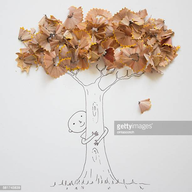 Conceptual boy hugging a tree