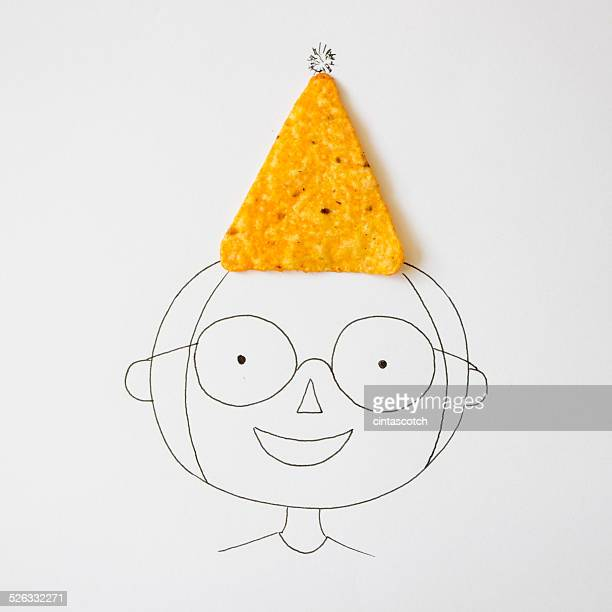 Conceptual boy wearing a party hat