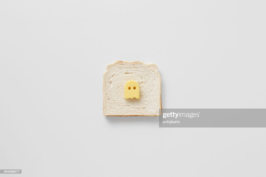 Conceptual butter ghost on bread