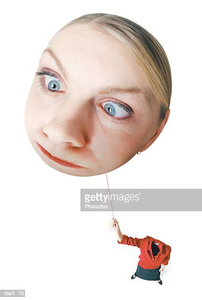conceptual caricature of a blonde caucasian woman in a red outfit as she hold onto her head by a string as it floats away