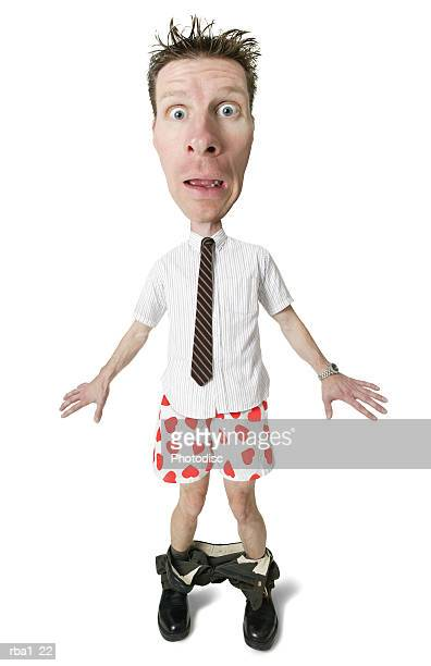 conceptual caricature of a caucasian man in shirt tie caught with pants down revealing heart boxers
