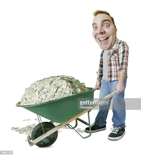 conceptual caricature of a caucasian man in work clothes as he pushes a wheelbarrow full of money