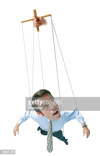 conceptual caricature of businessman in shirt tie hangs in air by strings as a marionette puppet