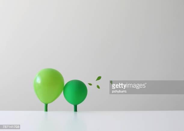 Conceptual green balloons as trees