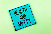 Conceptual hand writing showing Health And Safety. Business photo showcasing being in good condition harmless Workouts Healthy food written Sticky Note Paper the plain background.