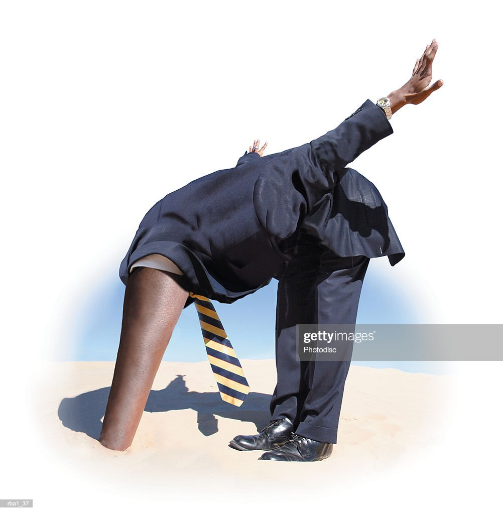conceptual photo of a business man in a suit stretching out a long neck burying his head in the sand