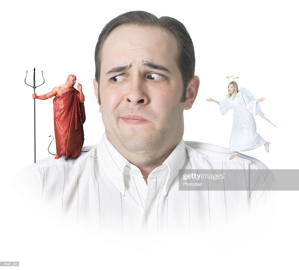 conceptual photo of a caucasian man with an angel and a devil on his shoulders as he confusedly glances to the devil