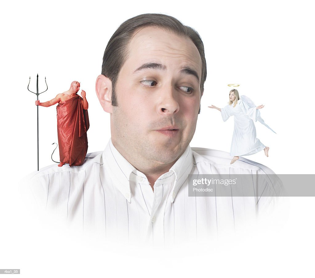 conceptual photo of a caucasian man with an angel and a devil on his shoulders as he confusedly glances to the angel : Stock Photo