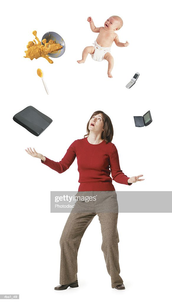 conceptual photo of a caucasian woman as she tries to juggle her professioal life with her home life : Stock Photo