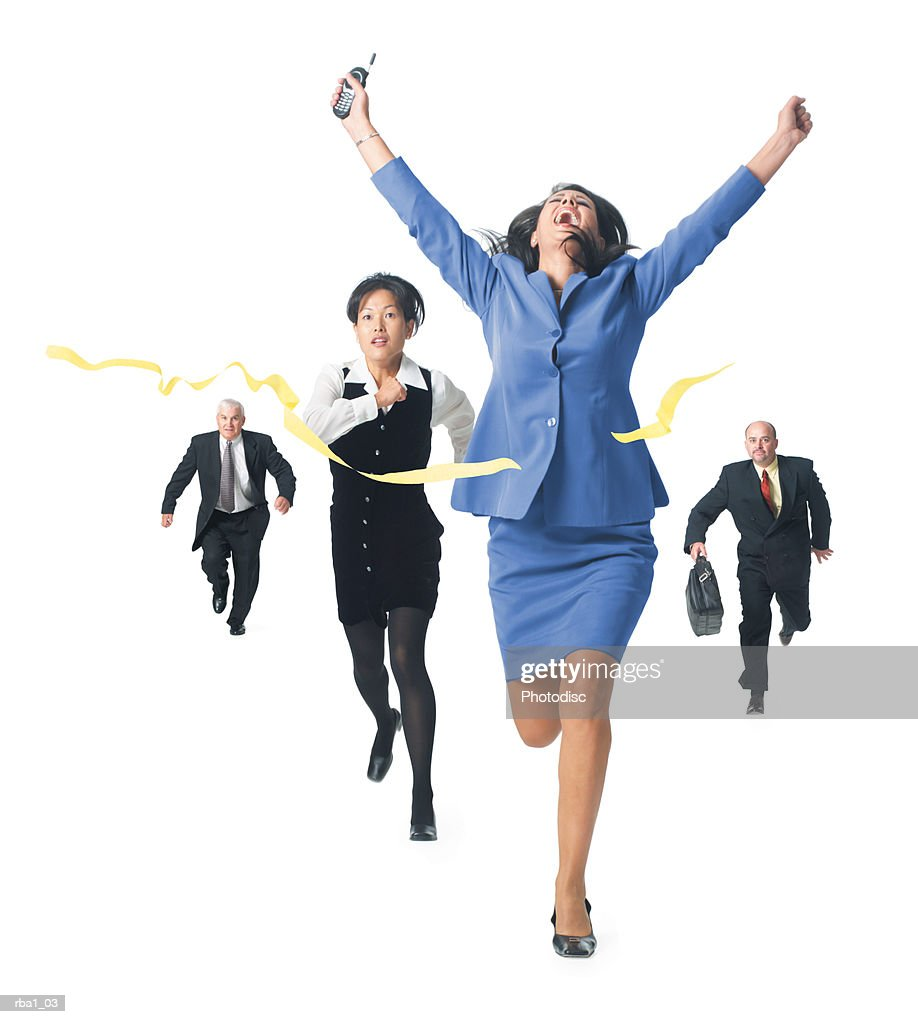 conceptual photo of a group of business people as they cross the finish line of a race