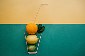 Conceptual photography. Citrus lemonade or juice from fresh fruits in a glass of tubes.