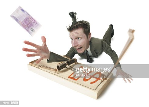 http://media.gettyimages.com/photos/conceptual-photogrpah-of-a-business-man-stuck-in-a-mouse-trap-as-he-picture-idrbrb_1669?s=170667a
