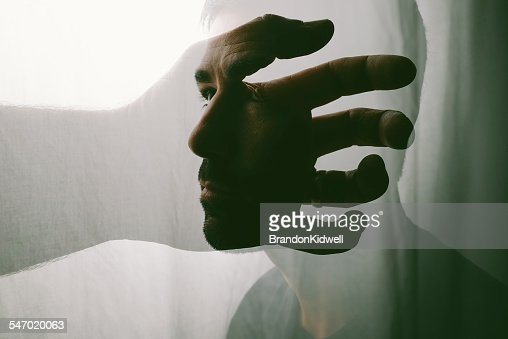 Conceptual portrait of a man searching within himself